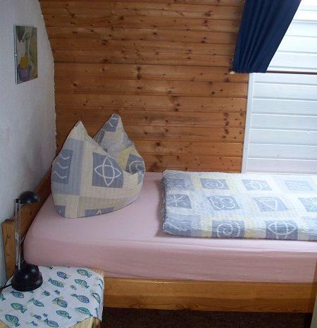3-Bett-Schlafzimmer